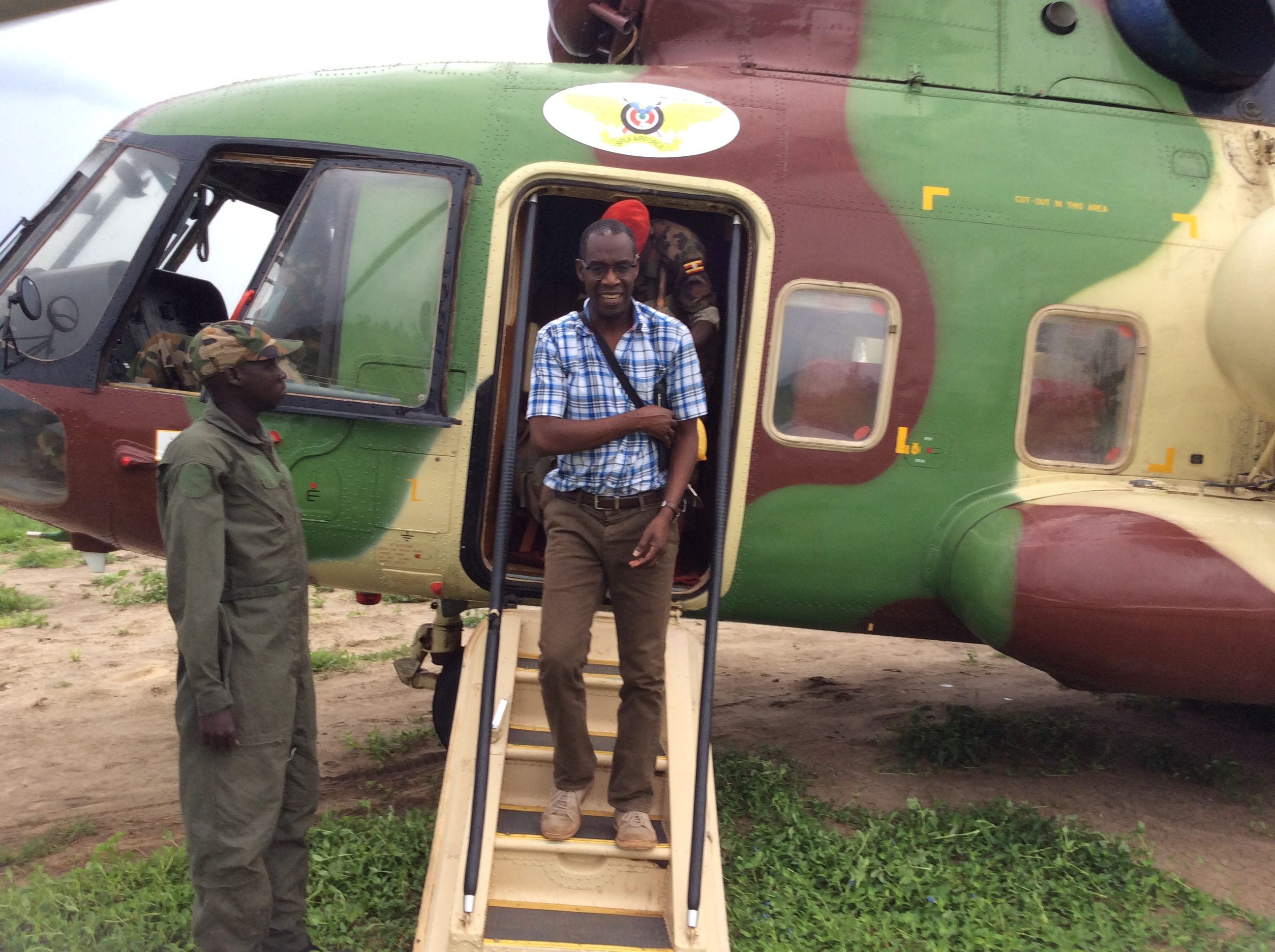 Opiyo arriving in Bor Toen, South Sudan aboard a South Suda Army helicopter on Wednesday July 16, 2015.